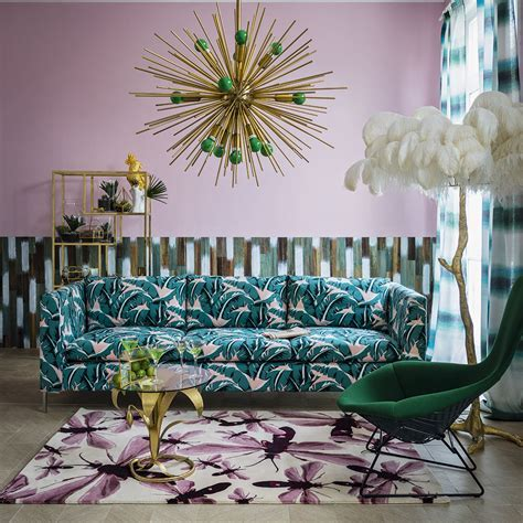 Contemporary living room with pink wall and tropical print