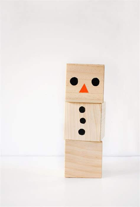 wooden wonderland snowman blocks craft allfreekidscraftscom
