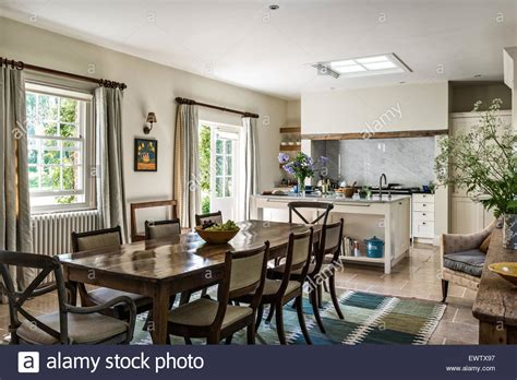 kitchen dining open plan antique dining table with chairs in open plan kitchen dining room stock photo royalty free