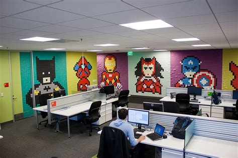 creative agency staff installs murals on their