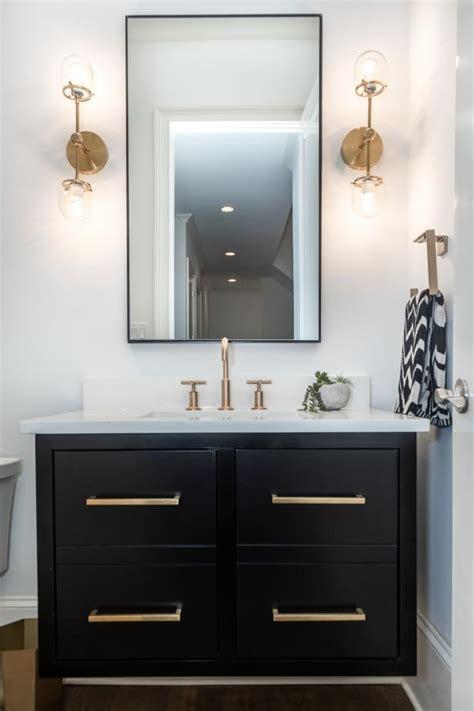 powder room  black vanity  gold toned faucet
