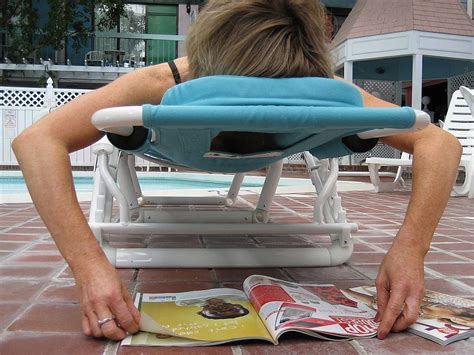 ergonomic chair takes out of poolside lounging