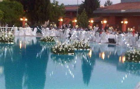 floating flowers  outdoor pool weddings lights