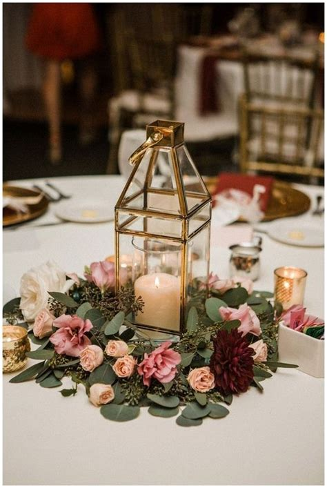 lantern wedding centerpieces with greenery and flowers in