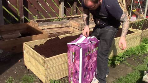 You can certainly buy pvc or composite wood container box kits, but they're not cheap and they have one massive shortcoming—to save on cost and shipping weight the planks that make up the side of the raised bed are hollow. Building a Raised Bed from Decking Boards - YouTube