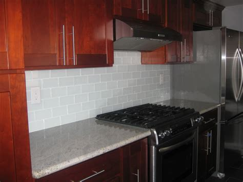 subway tile kitchen backsplash with cabinets