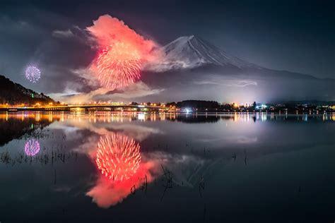 mt fuji  fireworks reflected  kawaguchiko feb