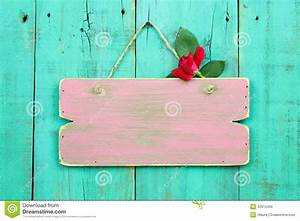 Blank Pink Weathered Sign With Red Flower Hanging On