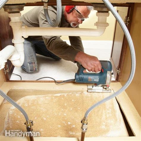 how to cut out a kitchen sink how to replace a sink base cabinet floor the family handyman