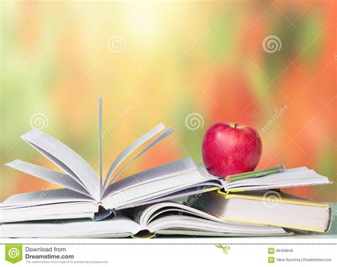 open books red apple school education background stock