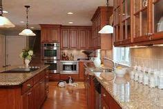 lights cabinets kitchen kitchen with cabinets and white quartz counters 7080