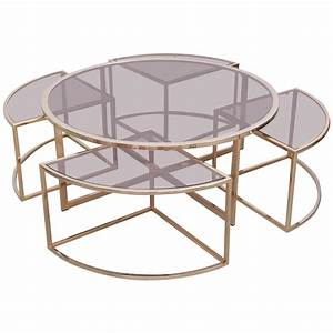 Round brass coffee table with four nesting tables by for Round stacking coffee table