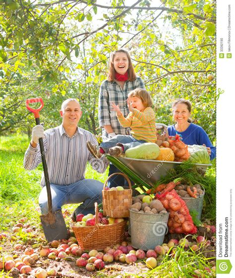 Happy Family With Harvest In Garden Stock Photo Image