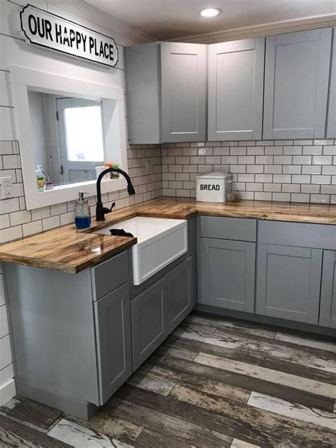 grey kitchen cabinets wood floor light gray cabinets wood floor and butcher block counters