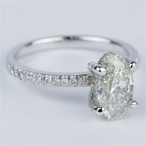 Delicate Pave Engagement Ring With Oval Diamond