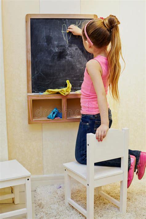 girl girl writes  chalk  blackboard royalty