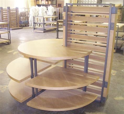 tiered display tables semi  wood  metal multi tiered jeans display stand kamenstein