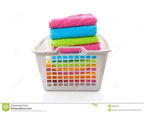 collapsible laundry laundry basket filled with colorful folded towels stock