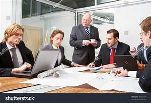 Corporate Design Team Meeting To Discuss Architectural ...
