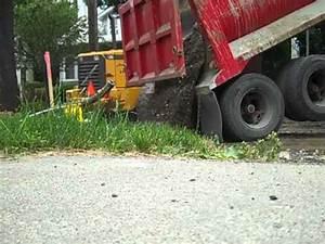 MACK Dump truck dumping gravel - YouTube
