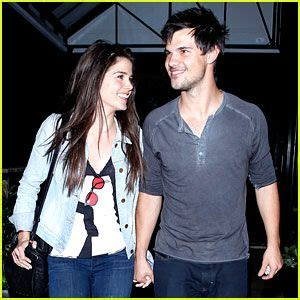 Taylor Lautner & Marie Avgeropoulos Hold Hands & Basically ...