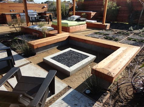 outdoor pit area designs custom concrete seating bench around gas firepit traditional fire back yard ideas
