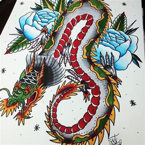 school dragon  blue rose buds tattoo design