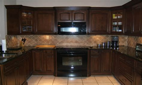 Long thin coffee table, dark brown kitchen cabinets with black appliances dark maple kitchen