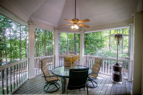 traditional porch with columns by atlanta sold