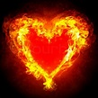 Brennendes Herz mit Feuerwerk auf einem dunklen ...