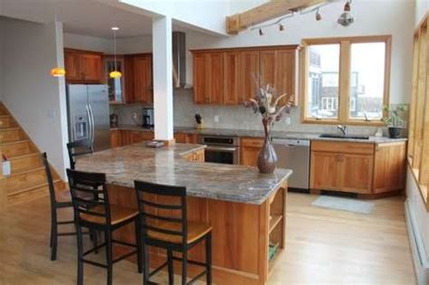 cherry cabinets with gray countertops light cherry cabinets kitchen light maple flooring