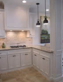 kitchen with off white cabinets stone backsplash and