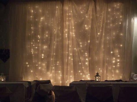 the diy wedding blog lights behind a cloth backdrop
