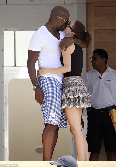 spain actress kiss erica packer shares a kiss with british singer seal on