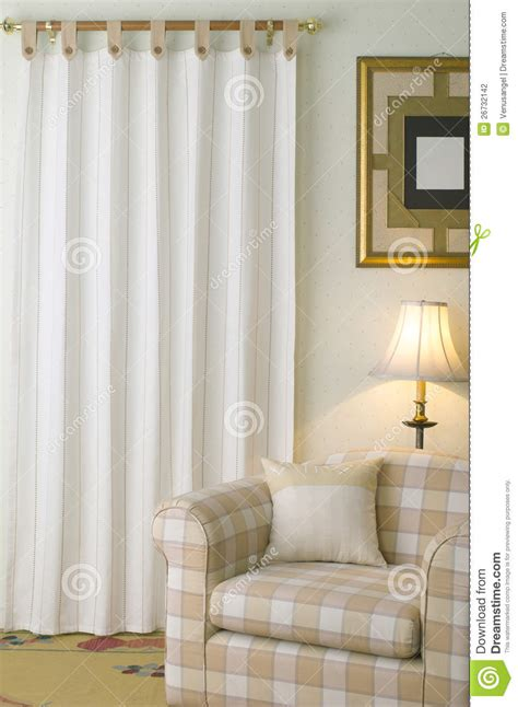 armchair and curtain in casual living room stock