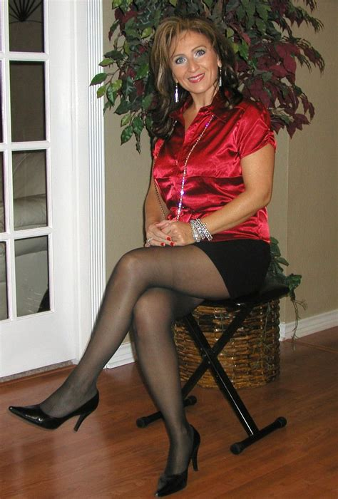 Over 40 Woman Sitting In Chair Wearing Black Pantyhose