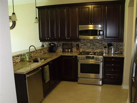 espresso cabinets stainless steel appliances  tile