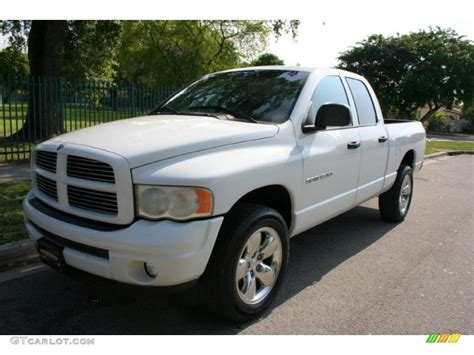 bright white dodge ram  sport quad cab