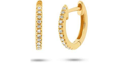 ron hami  yellow gold diamond huggie earrings  ctw  yellow