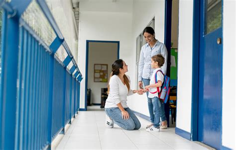 mother picking   kid  school  talking