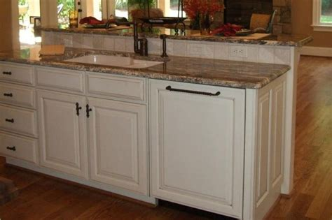 kitchen island with sink and dishwasher and island with sink bi level counter so guests are spared