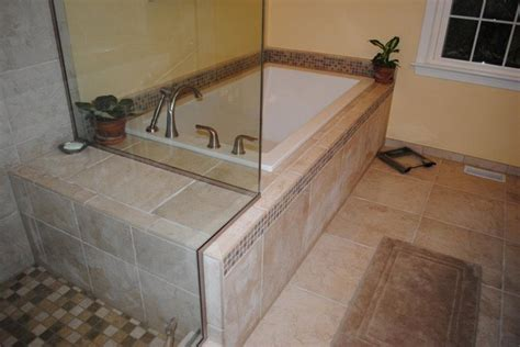white drop in tub tile floor tub surround and shower traditional bathroom other metro