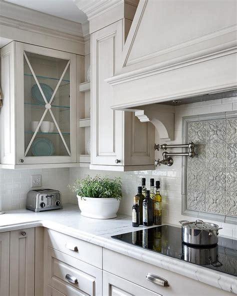 gray mosaic cooktop backsplash traditional kitchen
