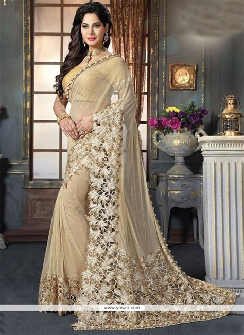 buy mesmerizing beige embroidered work fancy fabric