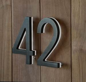 Like the idea of exposed wood entry doors for units with for Black metal house letters