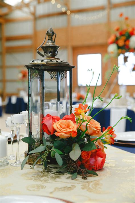 Table decor using lanterns with flowers Lanterns with
