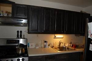 janets black caromal coloured oak cabinets fabulously With best brand of paint for kitchen cabinets with diy picture frame wall art