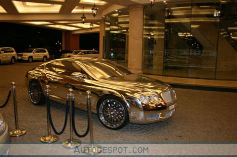 golden bentley continental gt spotted  dubai top speed