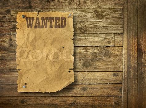 wild west wanted poster   wooden wall stock photo