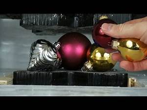 Shatterproof vs Traditional Ornaments Crushed By Hydraulic Press